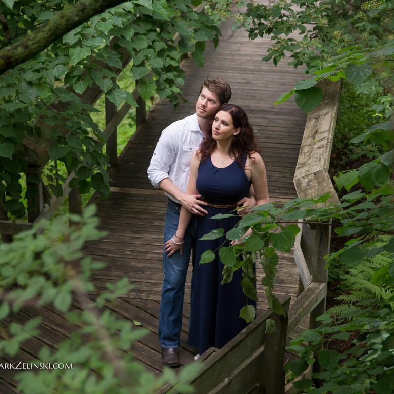 Couple Posing On Boardwalk In Woodland Garden