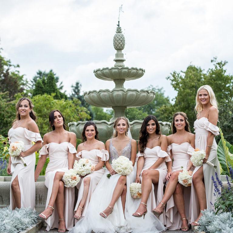 Wedding Bridal Party posing On Garden Fountain