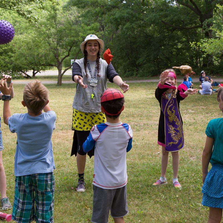Camp Staff With Children In Circle Credit Markzelinzki.com