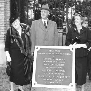 Hendrie Family Standing Behind Plaque