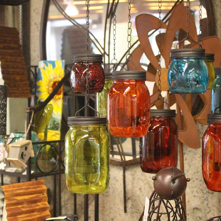 Shop Fall Display including coloured mason jars hanging from chains