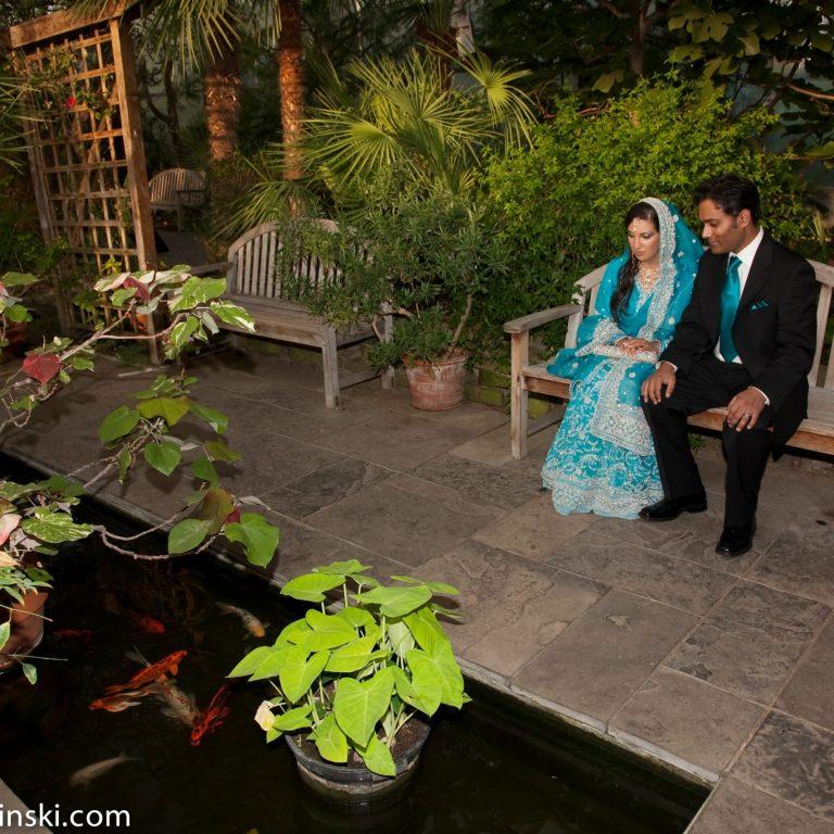 Bride and groom sitting on a bench in the Mediterranean garden