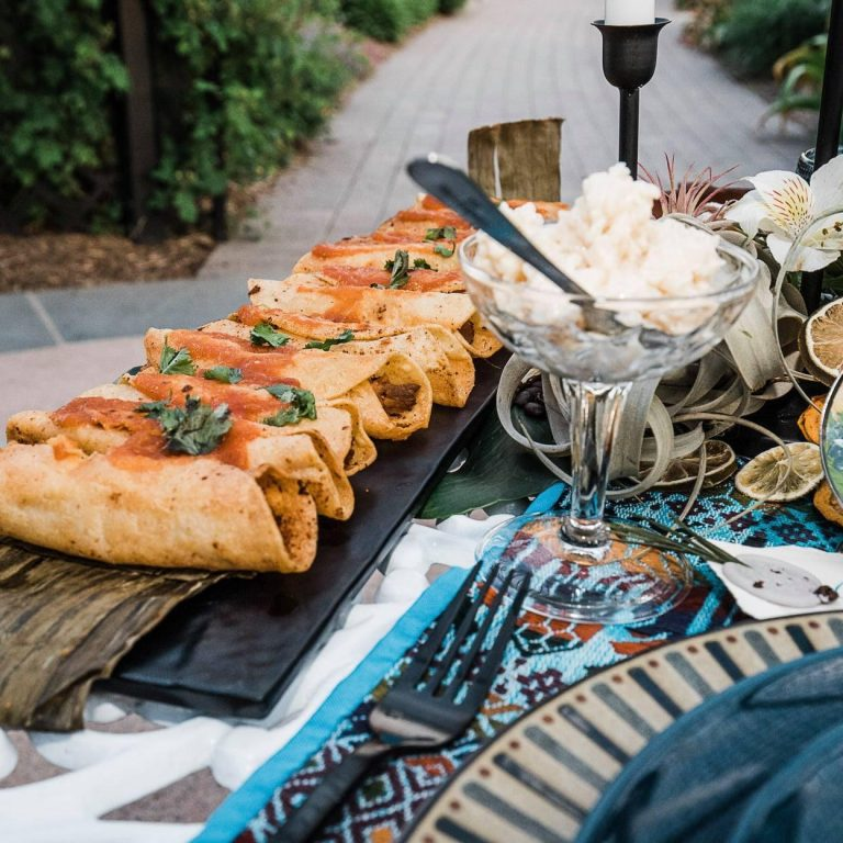 Catered spread of Guatemalan cuisine on an outdoor table