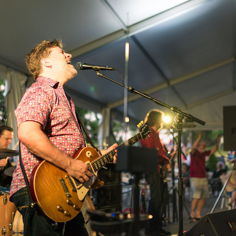 Paul Deslauriers band performing at garden music nights