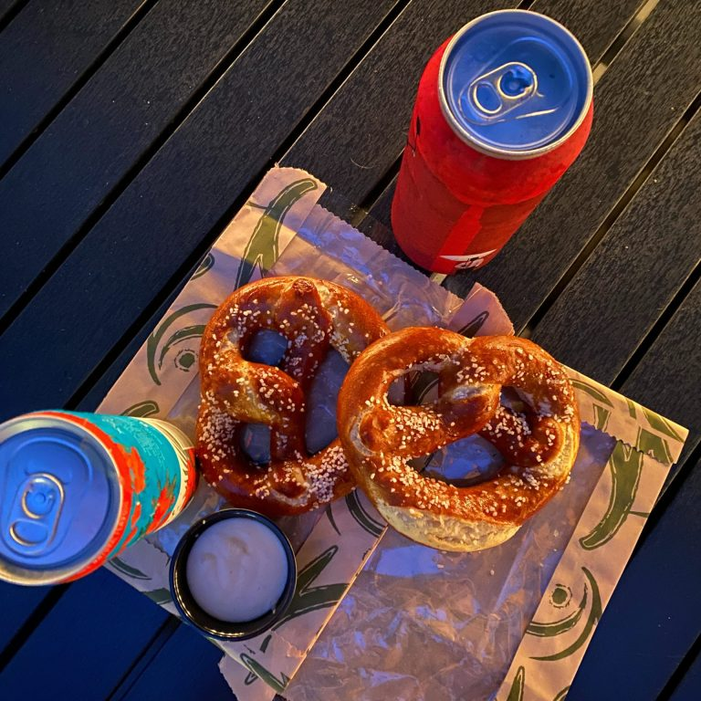 two soft pretzels and two canned drinks