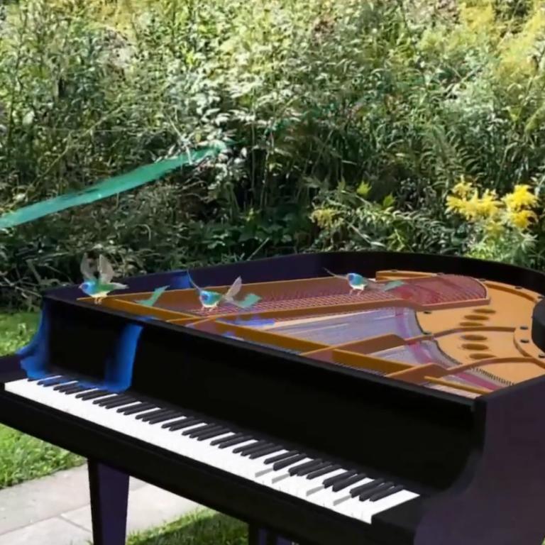 small blue birds flying around a black piano in Kippax Garden