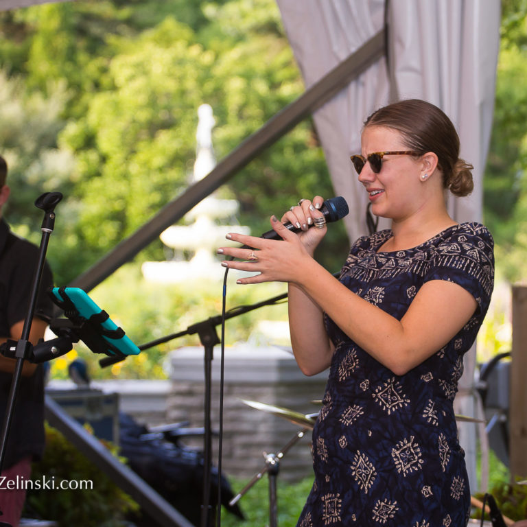 Jazz singer performing at garden music nights