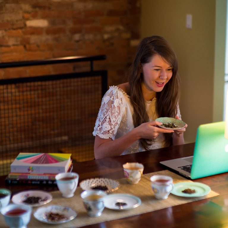 Katie Cyr hosting virtual tea talk with laptop