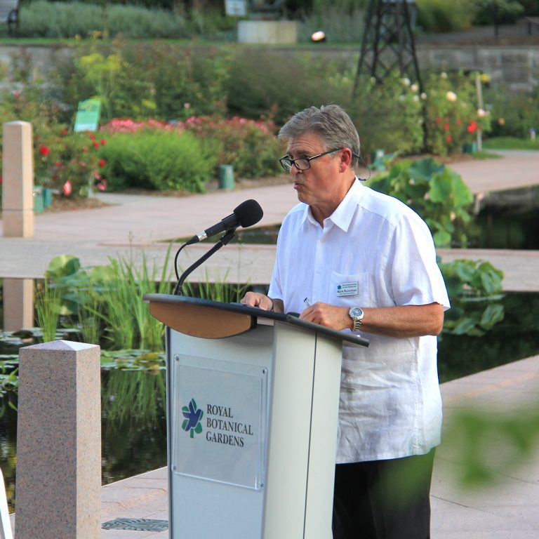mark runciman speaking at sculpture reveal in the rose garden