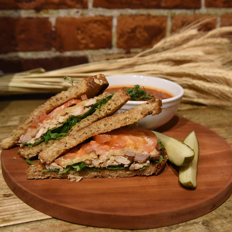 Turkey Club Sandwich On Wooden Platter