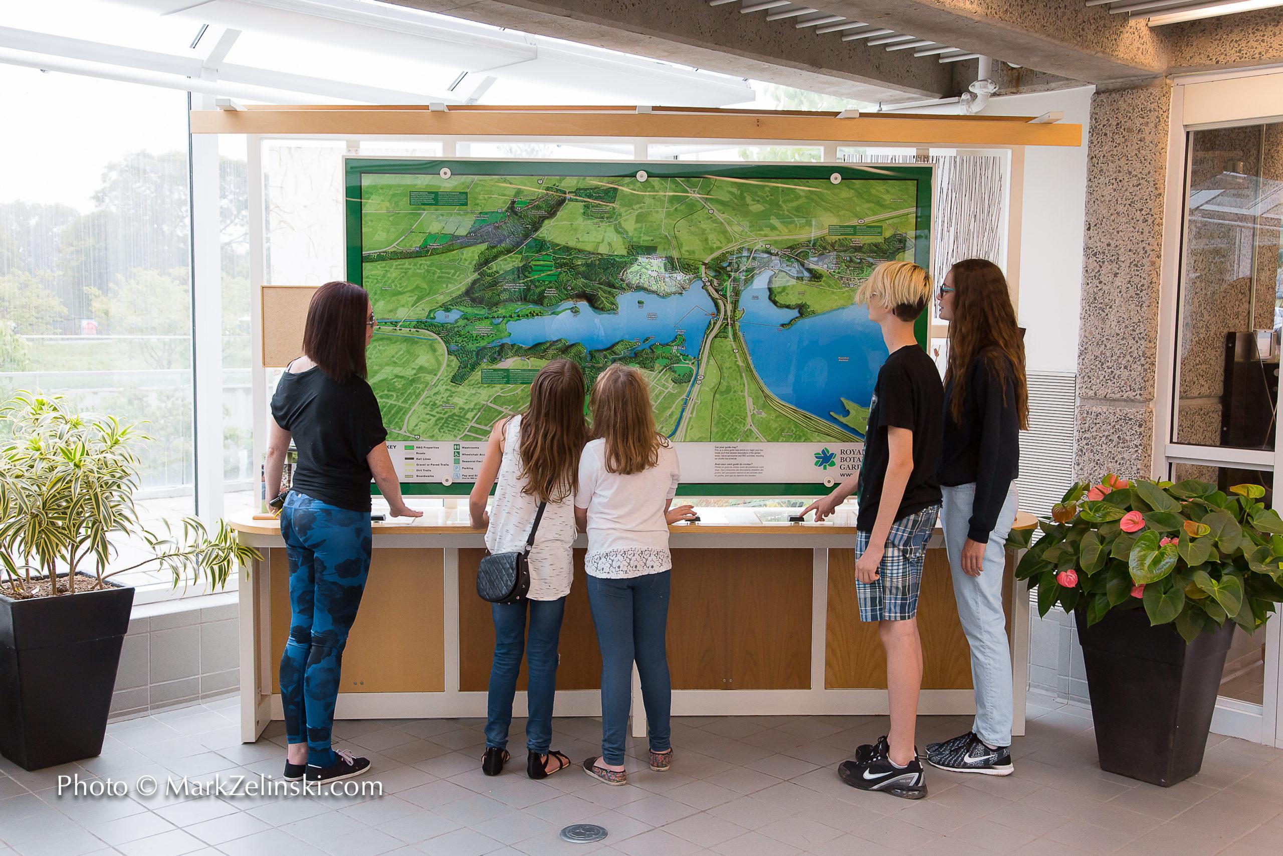 visitors looking at large rbg map credit markzelinski.com  scaled - Royal Botanical Gardens 680 Plains Road West Burlington On Canada